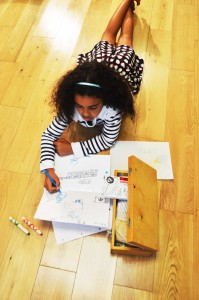Child drawing a scene