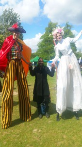 Wendy Shearer with stiltwakers - Tooting Common, Family Fun Day