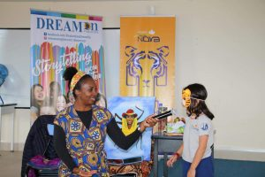 Wendy Shearer, professional Storyteller asking a child for her idea in the story